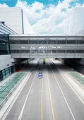 Road go through the modern office building at shanghai airport. — Zdjęcie stockowe