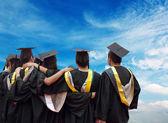 Back of chinese graduates — Stock Photo