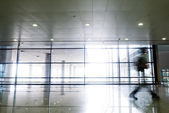 Silhouette in hall of office building — Foto de Stock
