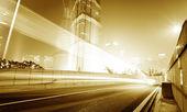 Ruchu samochód z plama światła — Zdjęcie stockowe