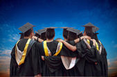 Back of chinese graduates with blue sky — Stock Photo