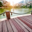 Platform beside lake with sunset in park — Stock Photo #27495045