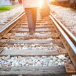 Stock Photo: At dusk the tracks, a lone pedestrian. — Stock Photo
