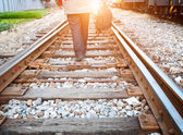 Stock Photo: At dusk the tracks, a lone pedestrian. — Foto Stock
