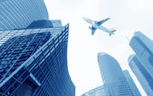The airplane with the city — Stock Photo