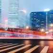 The light trails on the modern building background in shanghai china. — Stock Photo