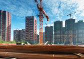 Building under construction with workers — Stock Photo