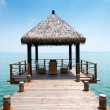Wooden jetty over the beautiful Maldivian sea with blue sky — Stock Photo #32688945