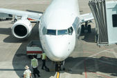 Commercial airplane parked at the airport — Stock Photo