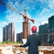 Architect looking comparing housing project — Stock Photo #32861873