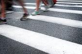 People walking on big city street, blurred motion zebra crossing — Stock Photo
