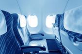 Empty aircraft seats and windows — Stock Photo