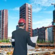 Architect looking comparing housing project — Stock Photo #34913205