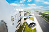 The airplane away from the city — Stock Photo