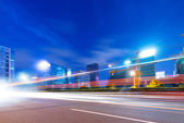 Light trails on the street at dusk — Stock Photo