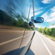 Car on the road with motion blur background — Stock Photo