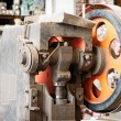Wheel and gears, detail of old paper guillotine — Stock Photo #36067601