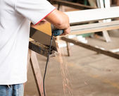 Worker using an angle grinder — Stock Photo