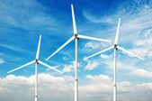 Green renewable energy concept - wind generator turbines in sky — Stock Photo