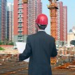 Architect looking comparing housing project — Stock Photo #37470053