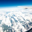 Wing aircraft in altitude during flight — Stock Photo #37474307