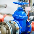 Industrial valve in petrochemical factory — Stock Photo #37474843