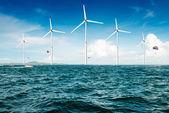 White wind turbine generating electricity on sea — Stock Photo