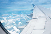 Wing aircraft in altitude during flight — Stock Photo