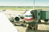 The plane at the airport on loading — Stock Photo