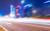 Light trails on the street at dusk in guangdong,China — Stock Photo