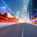 Asphalt road and modern city — Stock Photo