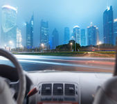Driver's hands on steering wheel — Stock Photo