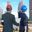 Architects looking housing project with building — Stock Photo #51712309