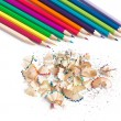 Shavings from sharpening and coloured pencils — Stock Photo
