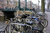 Several bicycle in a street of Amsterdam (Holland, Europe) — Stock Photo