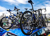A car carrying the team bikes in the Tour of Basque Country — Stock Photo