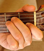 E Mayor position on a classical guitar — Stock Photo