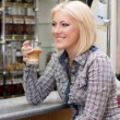 Beautiful blonde womwith coffee in cafe — Stock Photo #22242149