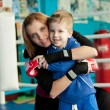 Family portrait. Mother and son in gym — Stock Photo #22507935