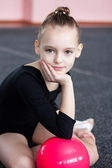 Small gymnast trains in the gym — Stock Photo