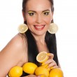 Pretty girl with lemons isolated on white — Stock Photo #41420713
