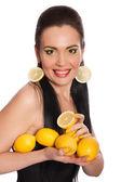 Pretty girl with lemons isolated on white — Zdjęcie stockowe