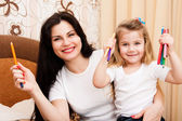 Cute little girl with her mother for drawing. — Stock Photo
