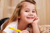 Cute little girl drawing with pencils. — Stock Photo