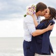 Romantic bride and groom are kissing near the sea. — Stock Photo #44607117