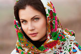 Russian girl in national headscarves — Stock Photo