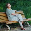 Royalty-Free Stock Photo: Elder lady on bench