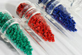 Dyed polymer resin in test-tubes in labortory — Stock Photo
