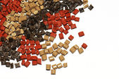 Variation of brown plastic granulates — Stock Photo