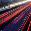 Light trail view at a busy highway — Stock Photo #37677029